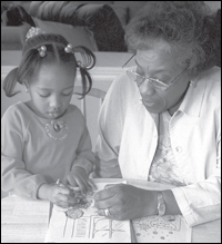 Image of an elderly woman and her grandchild.